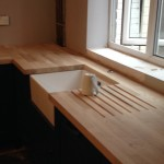 A solid wood kitchen worktop installed by midlandworktopfitters.co.uk